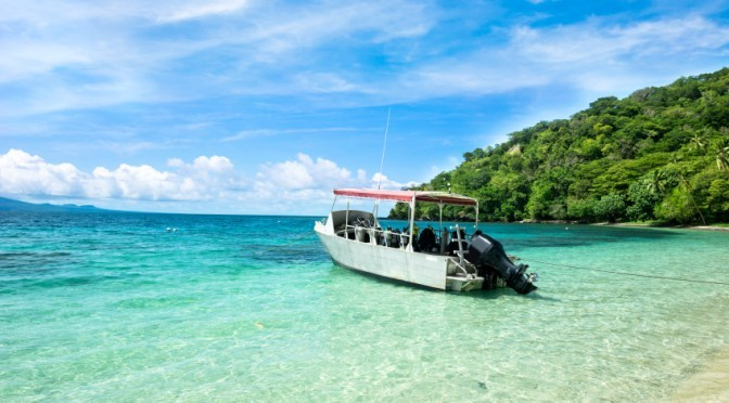 boat-by-beach-672×372
